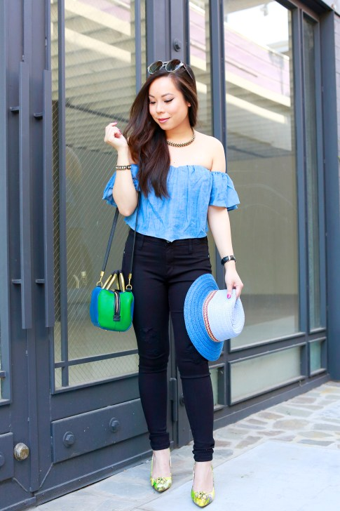 An Dyer wearing Guess Off The Shoulder Denim Corset Top
