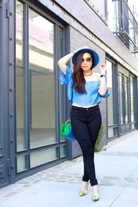 An Dyer wearing bcbg Blue Fedora with Guess denim off the shoulder top and green floral pumps