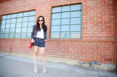 An Dyer wearing AX Windowpane Short Suit with Louis Vuitton Alma BB Carmine and shoedazzle pumps