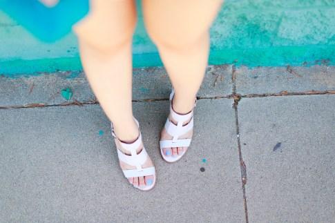 An Dyer wearing Arricci Harmony White Sandals, Essie Polish
