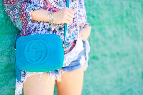 An Dyer wearing Gucci Soho Disco Teal Turquoise Suede