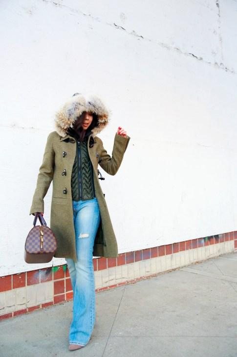 An Dyer wearing Dawn Levy Waverly Green Coat, Louis Vuitton Ribera Mm Damier, Aeropostale Light Flare Jeans