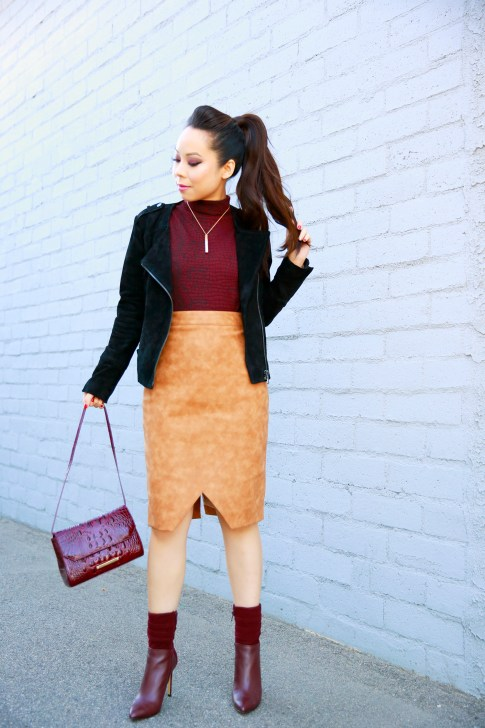 An Dyer wearing Pompadour Ponytail, Forever 21 Suede Jacket, House of CB Skirt, Guess Vvidlet Boots