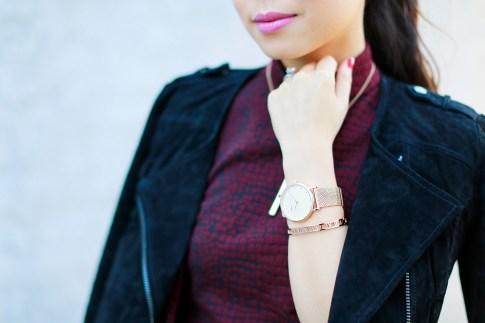 An Dyer wearing The Peach Box rose gold watch