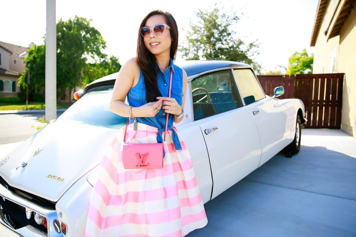 An Dyer wearing Chicwish Candy Pink Striped Full Midi Skirt and Louis Vuitton Louise Corail,