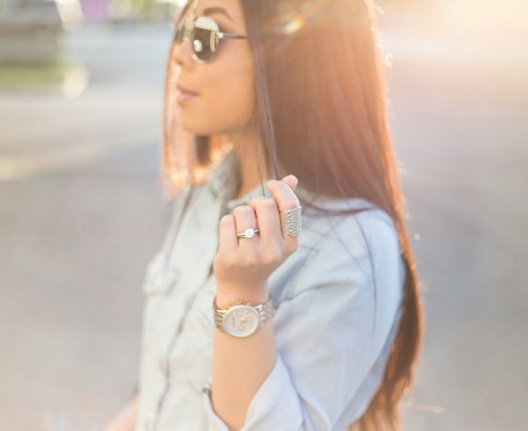 An Dyer wearing BCBGeneration Alexander The Jirt Chambray Denim Shirt, BesoBeso by Luka Candace Ring, Michael Kors MOther of Pearl Chronograph Watch, Mirrored Aviators