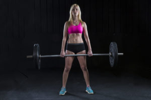 A female college student lifts weights