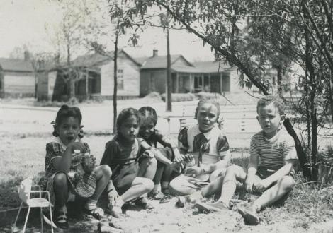 Pictured l to r: Ellen Long Aquaviva, daughter of Race Relations Administrator Herman Long, Beth hides behind her little sister Gail M. Thompson, Jean Welch-Wilson and Alex Bontemps, son of librarian Arna Bontempts.