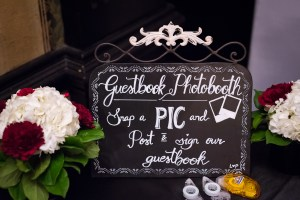Handwritten chalkboard guestbook photobooth sign at wedding
