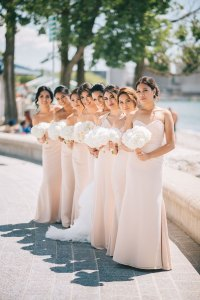 Bridal party in light pink bridesmaid dresses holding white floral bouquets at Toronto Wedding