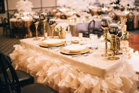Elegant cream coloured head table place setting