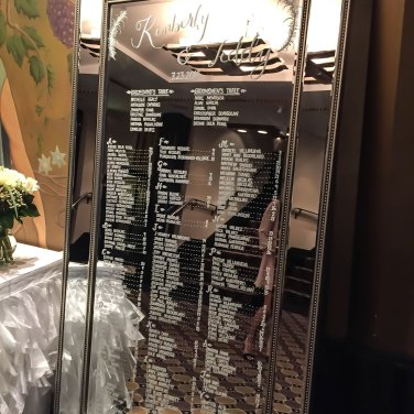 Handwritten wedding table number list on mirrored board at Toronto Wedding
