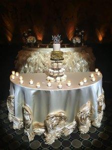 Wedding cake and cupcake on display