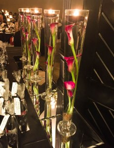 Calla Lily and candle centerpiece in pilsner vase