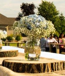 Light blue Floral centerpiece in mason jar