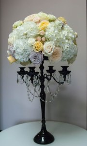 Assorted light floral centerpiece in candelabra vase with hanging crystals