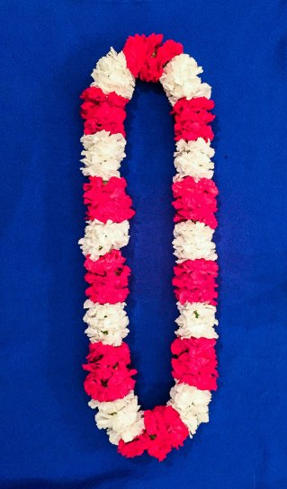 Pink and white Lei for Hawaiian-themed wedding