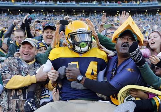 Green Bay Packers' James Starks (44) celebrates with fans after a five-yard touchdown reception during the first half of an NFL football game against the San Diego Chargers, Sunday, Oct. 18, 2015, in Green Bay, Wis. (AP Photo/Jeffrey Phelps)