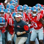 Mississippi football coach Hugh Freeze leads his team on to the field for their NCAA college football game against Vanderbilt in Oxford, Miss., Saturday, Sept. 26, 2015. No. 3 Mississippi won 27-16. (AP Photo/Rogelio V. Solis) ORG XMIT: MSRS603