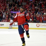 Washington Capitals left wing Alex Ovechkin (8), of Russia, celebrates his goal against the Carolina Hurricanes during the first period of an NHL hockey game, Tuesday, March 31, 2015, in Washington. It was Ovechkins' 50th goal of the year. (AP Photo/Nick Wass) ORG XMIT: VZN101