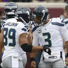 Seattle Seahawks wide receiver Doug Baldwin (89) celebrates his 20-yard touchdown reception with quarterback Russell Wilson (3) in the first half of an NFL football game against the Minnesota Vikings, Sunday, Dec. 6, 2015 in Minneapolis. (AP Photo/Ann Heisenfelt)