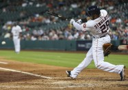Jun 11, 2014; Houston, TX, USA; Houston Astros first baseman Jon Singleton (28) drives in a run with a fielders choice during the third inning against the Arizona Diamondbacks at Minute Maid Park. Mandatory Credit: Troy Taormina-USA TODAY Sports