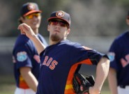 Houston Astros pitcher Ken Giles goes through a drill during a spring training baseball workout, Friday, Feb. 19, 2016, in Kissimmee, Fla. (AP Photo/John Raoux)