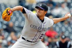 Colorado Rockies starting pitcher Jorge De La Rosa delivers against the San Diego Padres in the third inning during a baseball game, Sunday, April 14, 2013, in San Diego. The Rockies won 2-1. (AP Photo/Alex Gallardo)