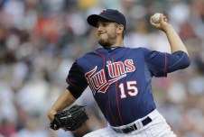 MINNEAPOLIS, MN - APRIL 13: Glen Perkins #15 of the Minnesota Twins pitches against the Kansas City Royals during the seventh inning of their game on April 13, 2011 at Target Field in Minneapolis, Minnesota. Royals defeated the Twins 10-5. (Photo by Hannah Foslien/Getty Images)