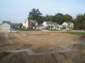 A prepared building lot for a new house.
