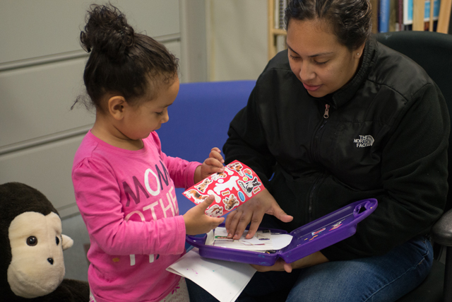 Angelica Pabon with her 3-year-old daughter, Liliana, who attends Erie Neighborhood House, a preschool program that provides academic and mental health services for young children. Her older child, Julian, received help there after witnessing the murder of his father. (Photo: Julienne Schaer)