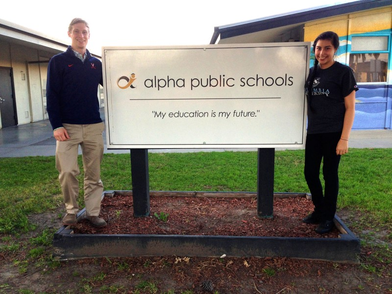 Soon-to-be principal Will Eden, left, and student Ana Wallace, a member of the Alpha: Cindy Avitia High School design team, stand outside one of two Alpha middle schools in East San Jose, Calif.
