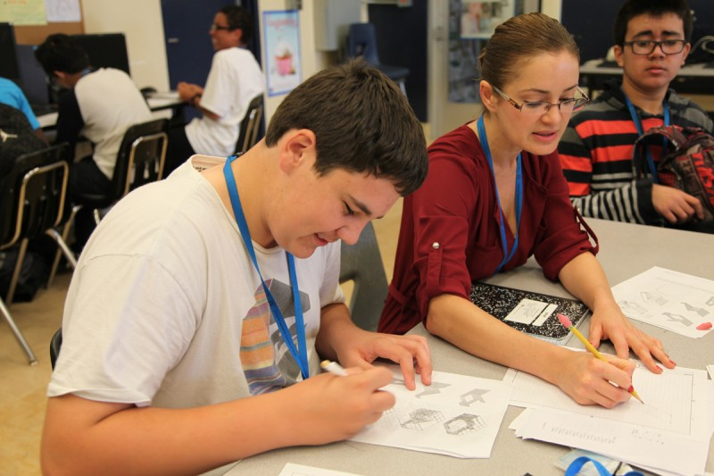 Shadi Pejuhesh (on right) assists a small group in her ninth-grade Introduction to Design class at Kearny High School in San Diego, California. Pejuhesh holds a degree in civil engineering from University of California Davis and has eight years' experience working as an engineer in the private and public sectors.