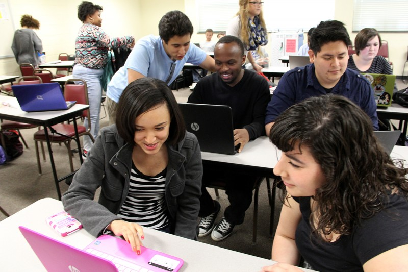 """Fourth year students talk amongst themselves during a free period at Johnston County Early College in Smithfield, N.C. Michaela Iacono (right) describes the school as """"like a family."""""""