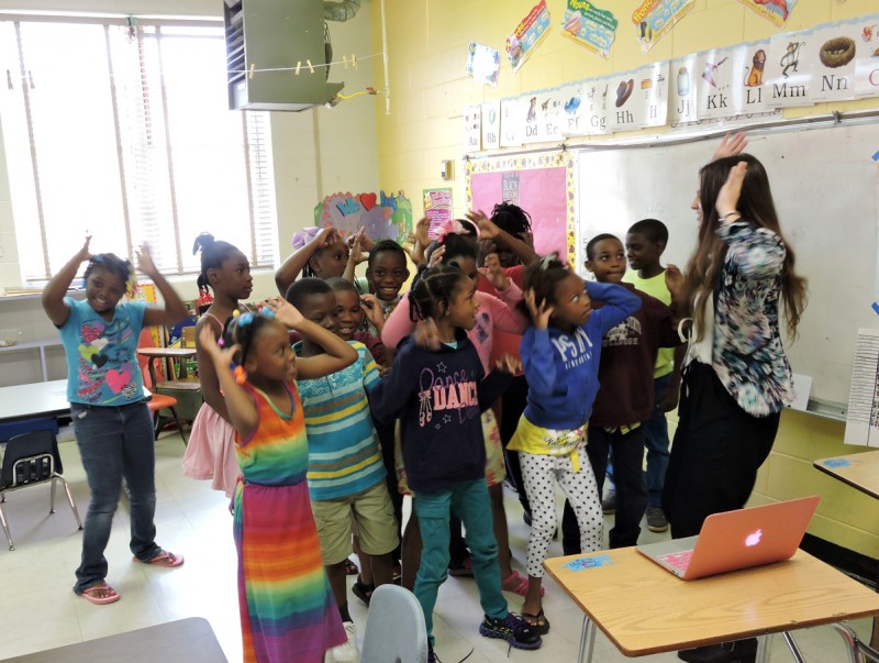 Teach for America trainee Paige Eslinger dances with third graders at a summer school program at East Sunflower Elementary in the Mississippi Delta.