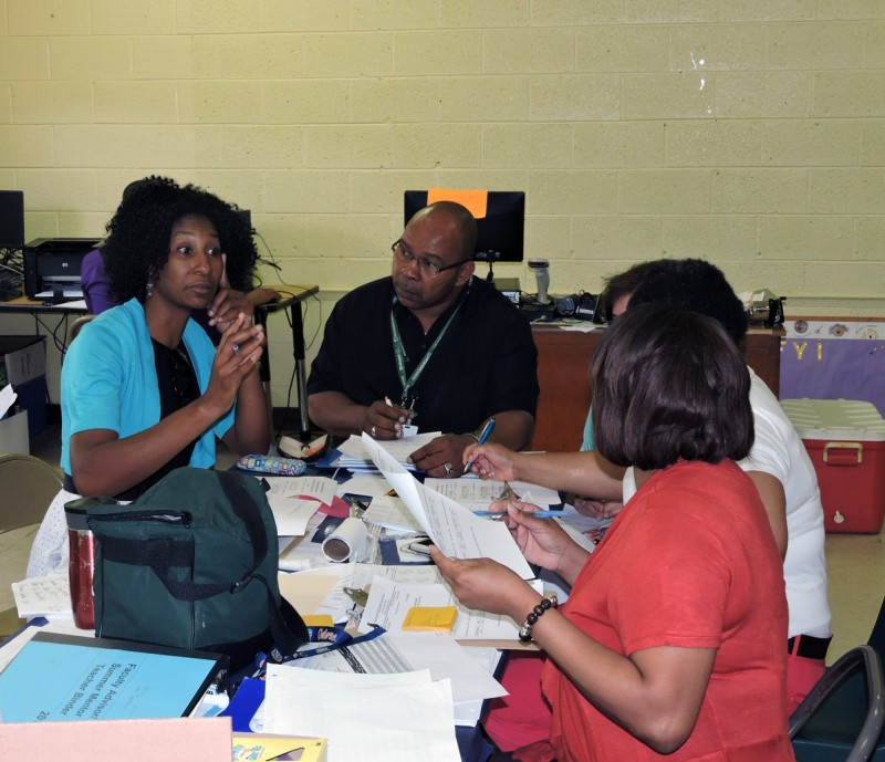 Frankie Blackmon, director of federal programs in Sunflower County, speaks during a meeting with the summer school staff. Earnest Nelson, site coordinator, sits to her left.