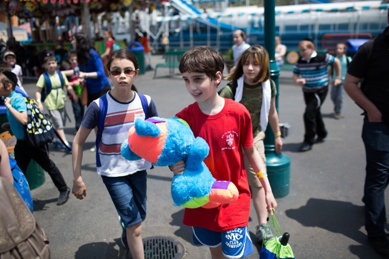 Student Etai Kurtzman, 12, wins a bear at the Roll-A-Ball game at Coney Island.