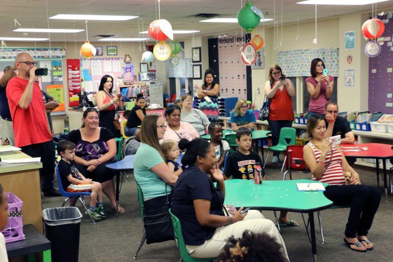 Families watch as students perform alphabet, number and color songs on the final day of pre-K camp this August.