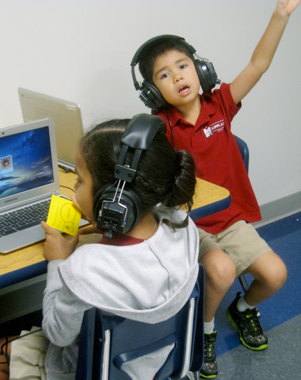 At the beginning of the school year, Daniel Rodezno, a kindergartener at KIPP Austin Obras, asks for help in logging on to his computer. (Gail Robinson)