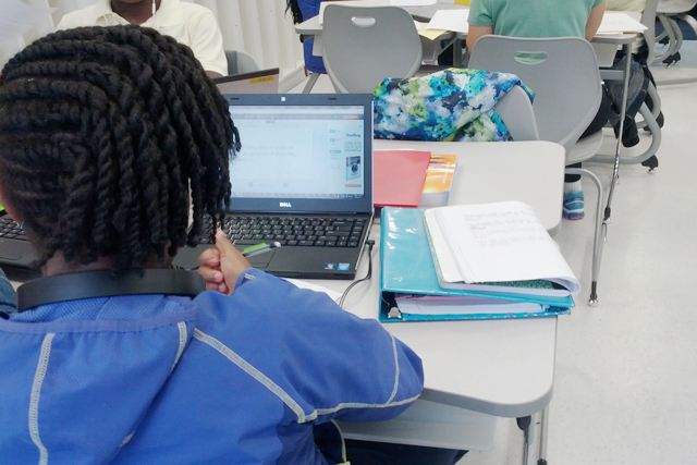 A student in a fifth grade class at Anne Beers Elementary School works on a computer lesson that allows her to move faster or slower than classmates in the same class. (Photo: Nichole Dobo)