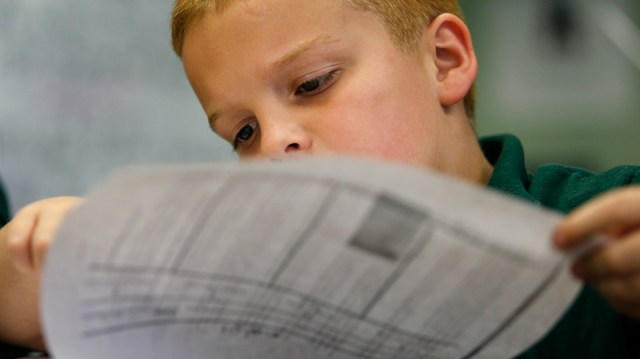 """4th grader Colby Downs works on a test as teacher Lora Johnson works with students at George Cox Elementary School in Gretna, Thursday October 18, 2012. Some, including Jefferson Parish School Board Superintendent James Meza fear that value added testing leads teachers to simply teach to the test, and that early learning indicators known as DIBELS (Dynamic Indicators of Basic Early Literacy Skills) scores can easily become the goal rather than the method. """"I can see how some teachers could feel that way,"""" said Greer Palmisano. """"If I've only got this much experience and…I'm totally panicked,"""" she said hypothetically, """"maybe I'm not going to worry too much about the math."""" (Photo by Ted Jackson, Nola.com / The Times-Picayune)"""