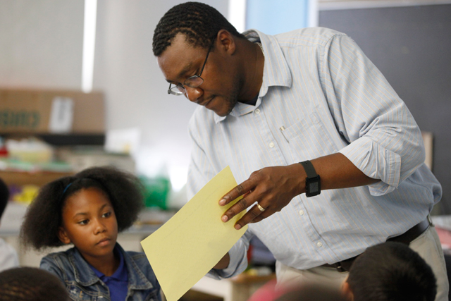 Nydresha with her sixth-grade science teacher, Henie Parillon. Science is one of her most difficult subjects. (Amanda Brown / NJ Spotlight)
