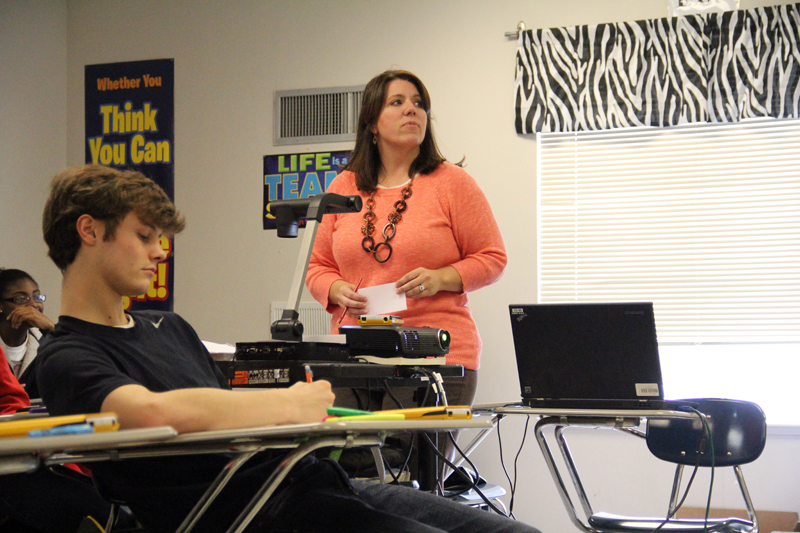 Molly Berry, an algebra teacher at Strayhorn High School in Tate County, teaches parabolas to her class. Berry says that consistent leadership and high expectations have helped the district improve under state control. (Photo: Jackie Mader)