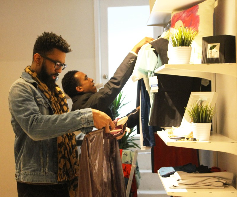 Shoppers exploring the clothes of Ortiz Industry