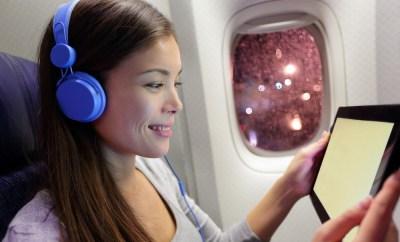 Woman headphones tablet