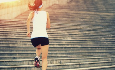 woman running up stairs exercising