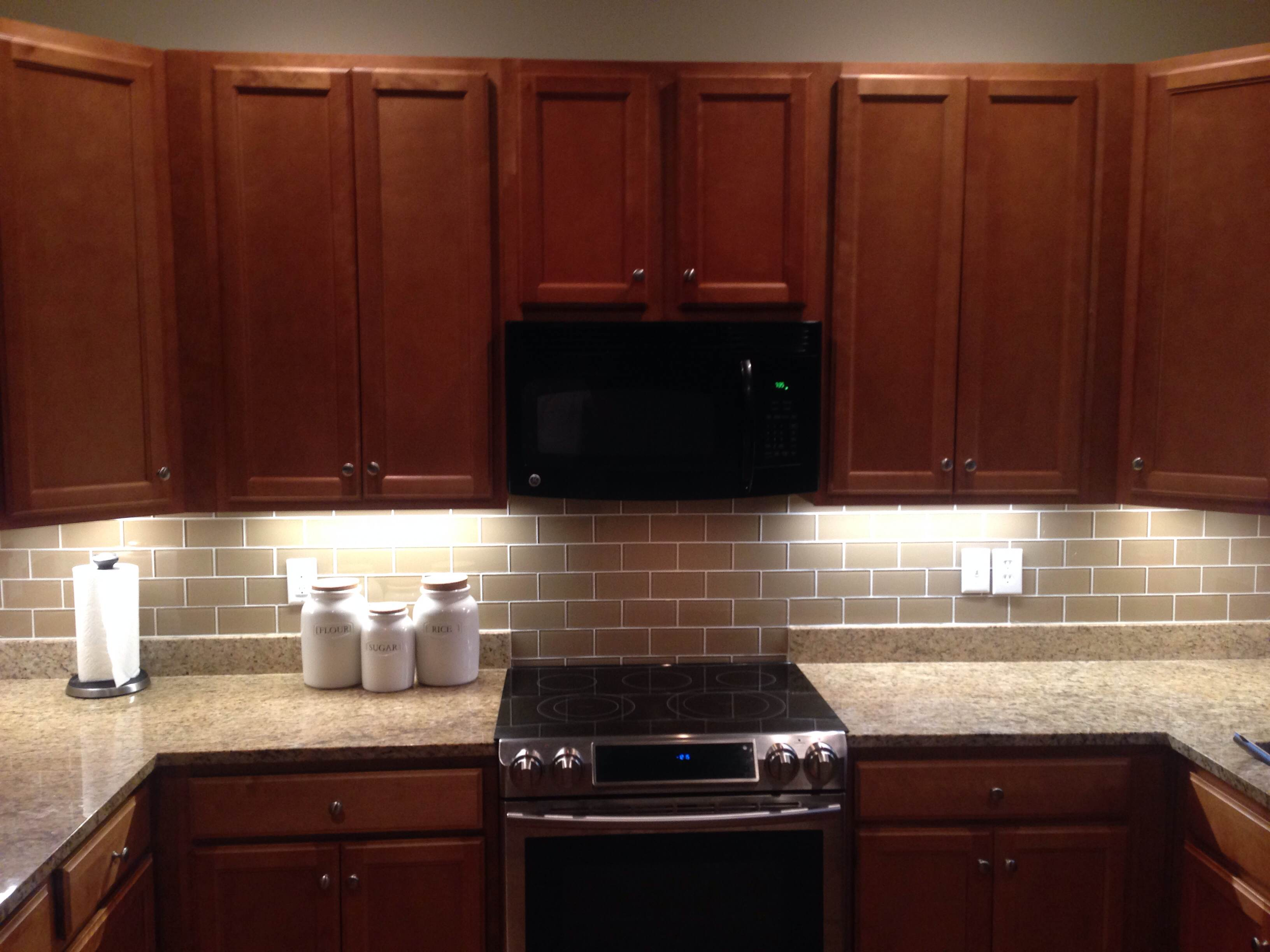 Black And Grey Kitchen Backsplash Grey Wall With Brown Laminated Wooden Wall Cabinet And