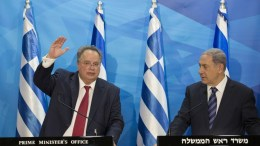 A handout picture made available by the Israeli Government Press Office (GPO) of Greek Foreign Minister Nikos Kotzias (L) and Israeli Prime Minister Benjamin Netanyahu (R) shake hands during a press conference at the Prime Minister's Office in Jerusalem, Israel, 06 July 2015. Nikos Kotzias is on a two days visit to Israel. EPA/KOBI GIDEON / HANDOUT ISRAEL OUT HANDOUT EDITORIAL USE ONLY/NO SALES
