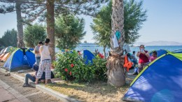 Migrants dwell at a makeshift camp site on the Greek island of Kos, Greece, 16 August 2015. The Greek island is struggling with a major influx of refugees and migrants amidst the financial crisis and the height of the tourist season. EPA/ODYSSEUS