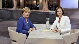 A handout picture made available on 16 August 2015 by German public broadcaster ZDF of German Chancellor Angela Merkel (L) and head of ZDF's Berlin studios, Bettina Schausten (R) during the traditional summer interview in Berlin, Germany, 16 August 2015. Merkel gave the traditional interview upon her return from summer vacations with Greece and migrant crisis likely to top the interview's agenda. PHOTO: JUERGEN DETMERS/ZDF EPA/JUERGEN DETMERS/ZDF